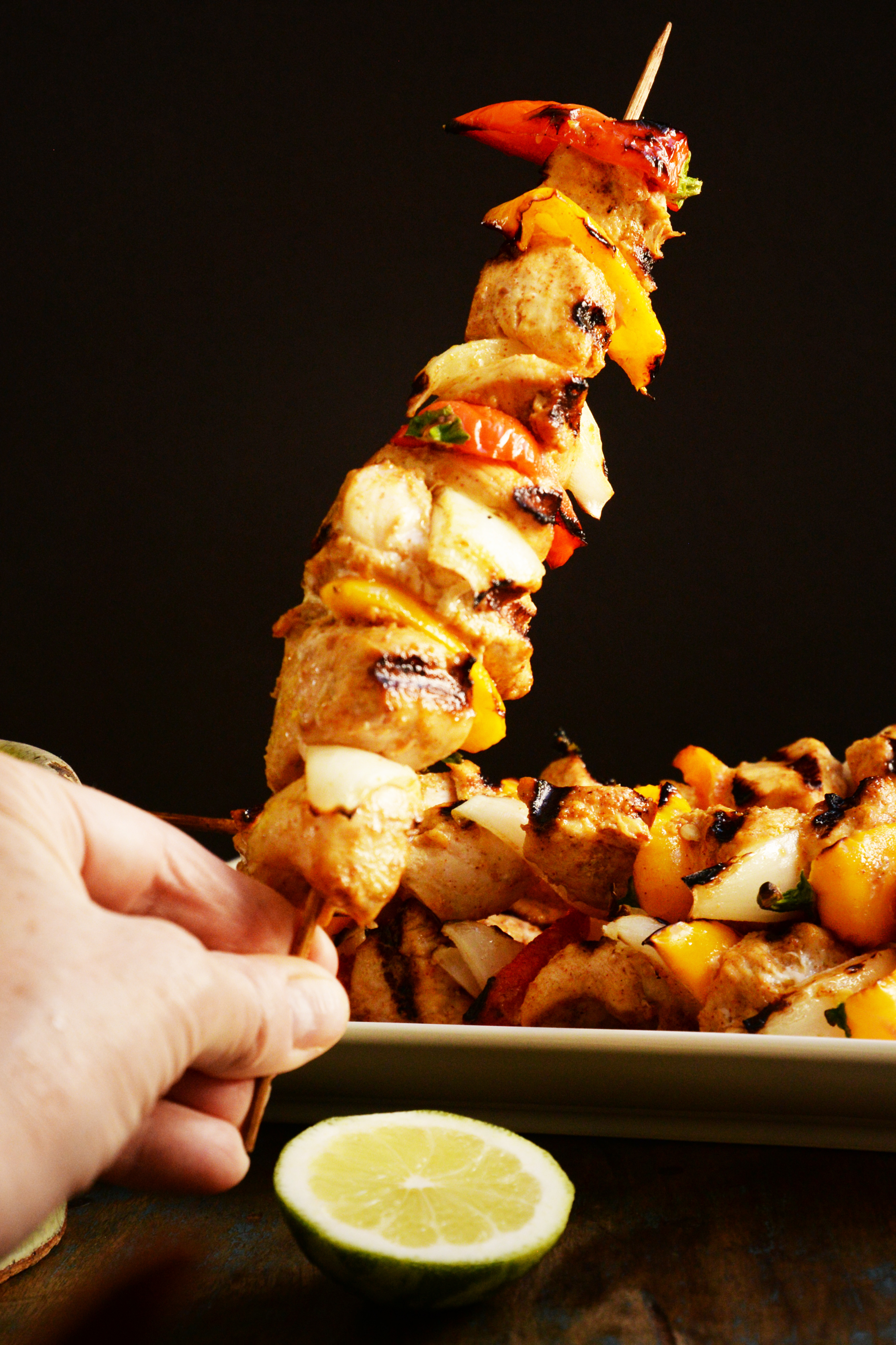 Grilled Fajita Chicken Kabobs-Kabob held vertically.