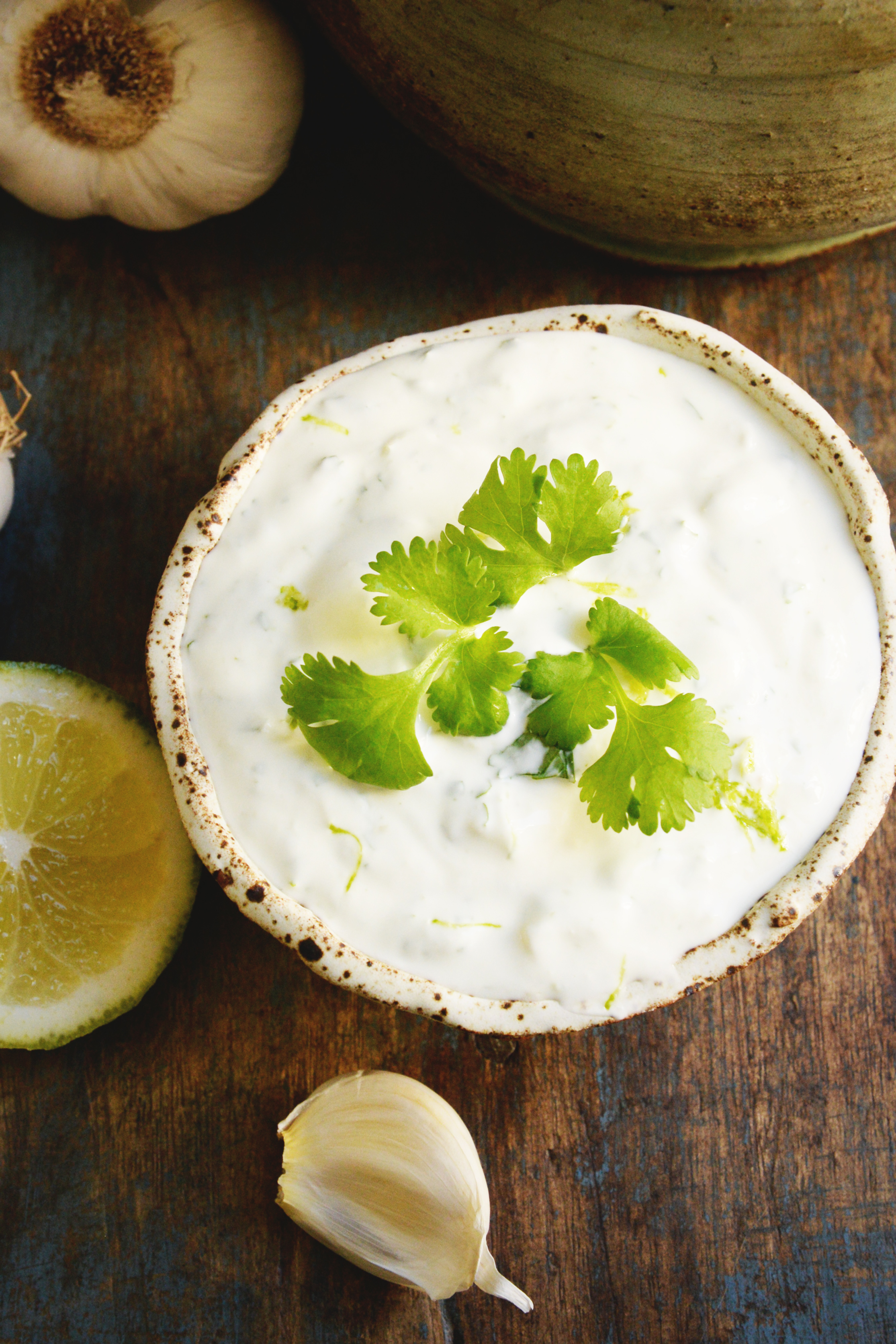 Creamy Cilantro Lime Dressing-garnished with cilantro.