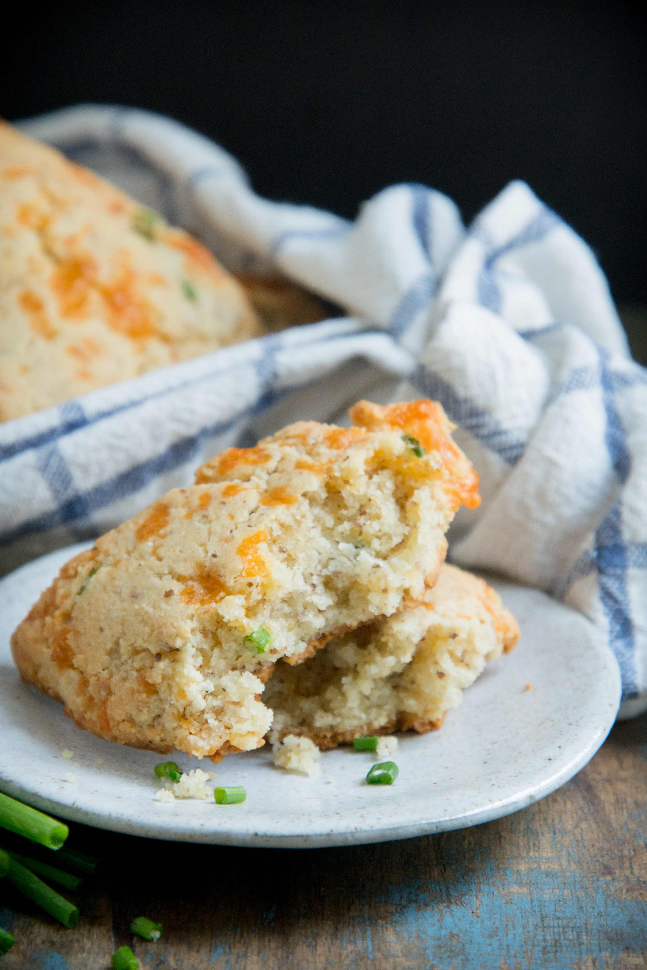 Low-Carb Cheddar Biscuits -one biscuit broken in half.