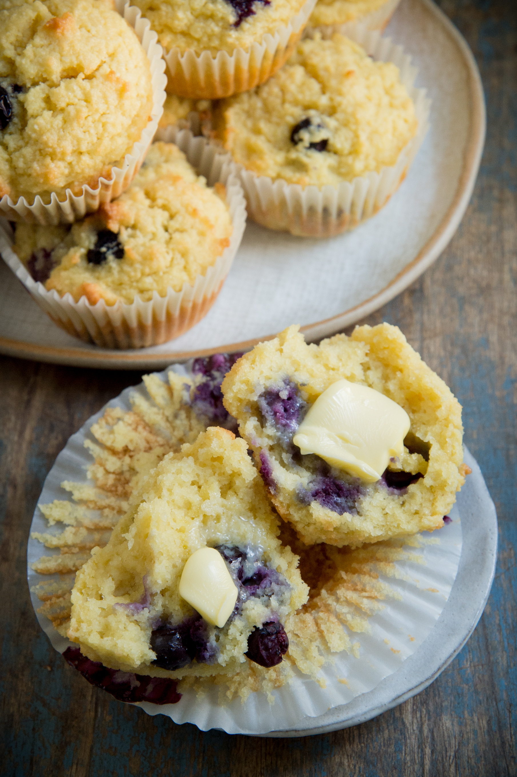 Low Carb Blueberry Muffins-Overhead with butter.