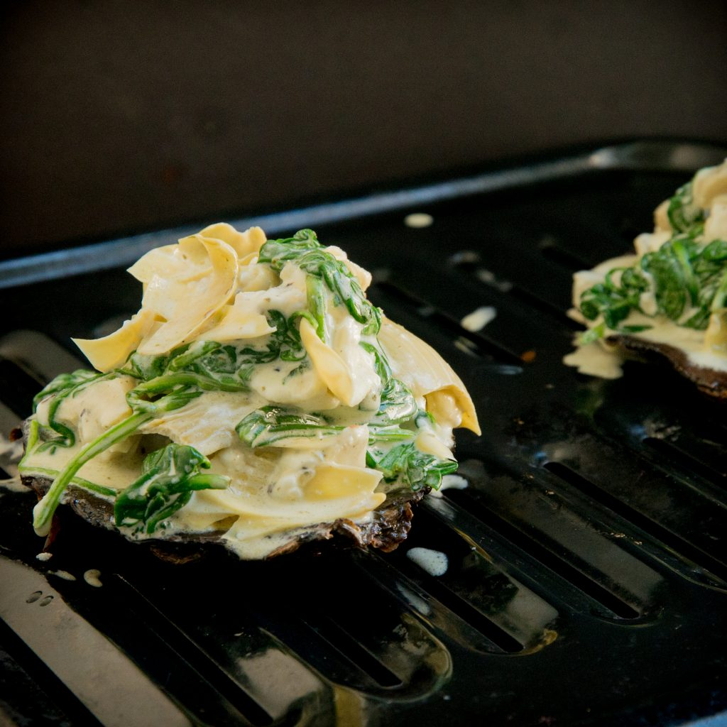 Spinach and Artichoke Stuffed Mushrooms-Adding the stuffing