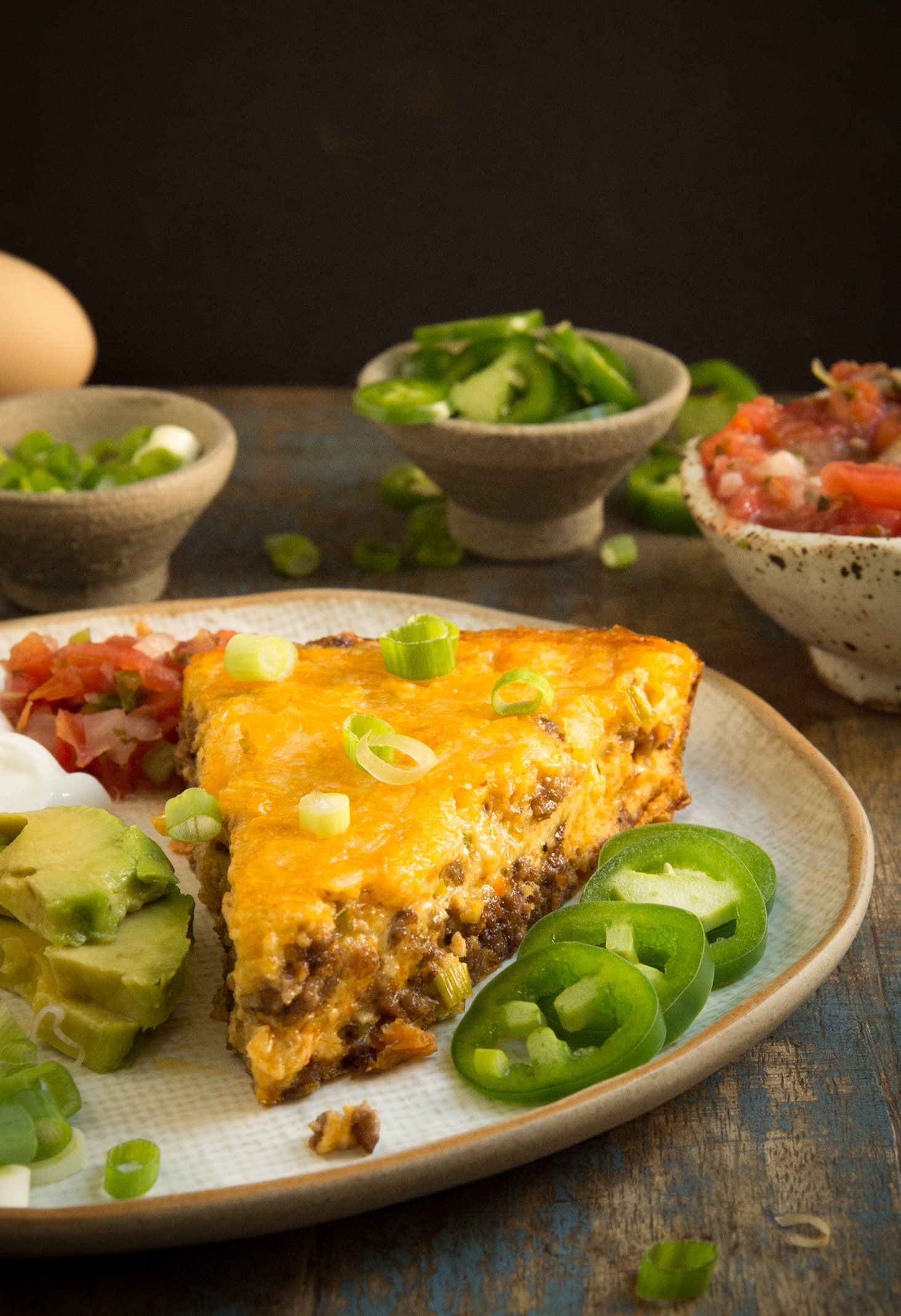 Keto Low-Carb Crustless Taco Pie -Close-up with toppings.