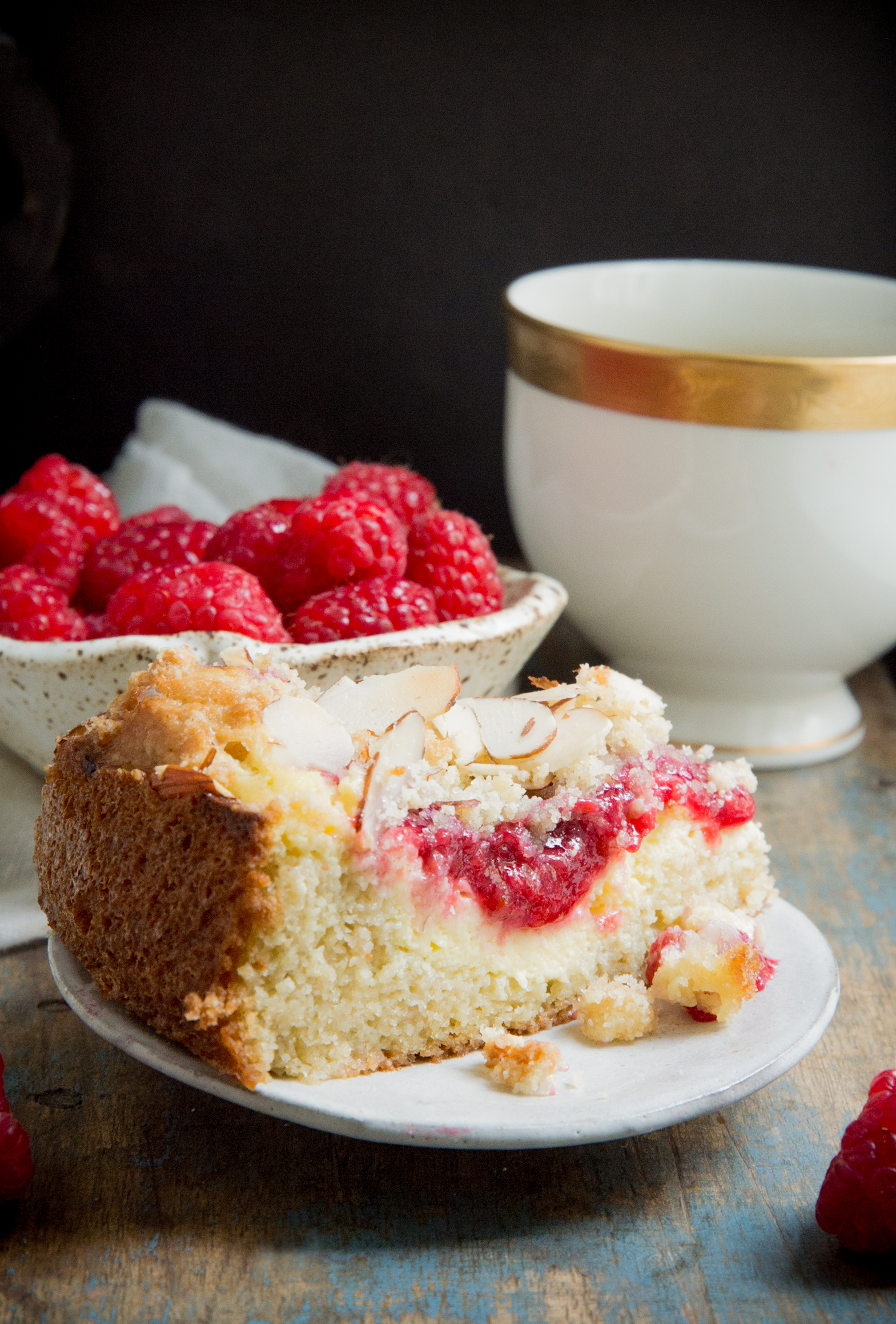 Keto Raspberry Cream Cheese Coffee Cake-with raspberries in background.
