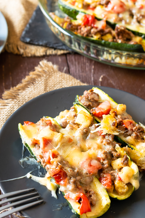 Keto Cheesy Zucchini Burrito Boats-taking a bite.