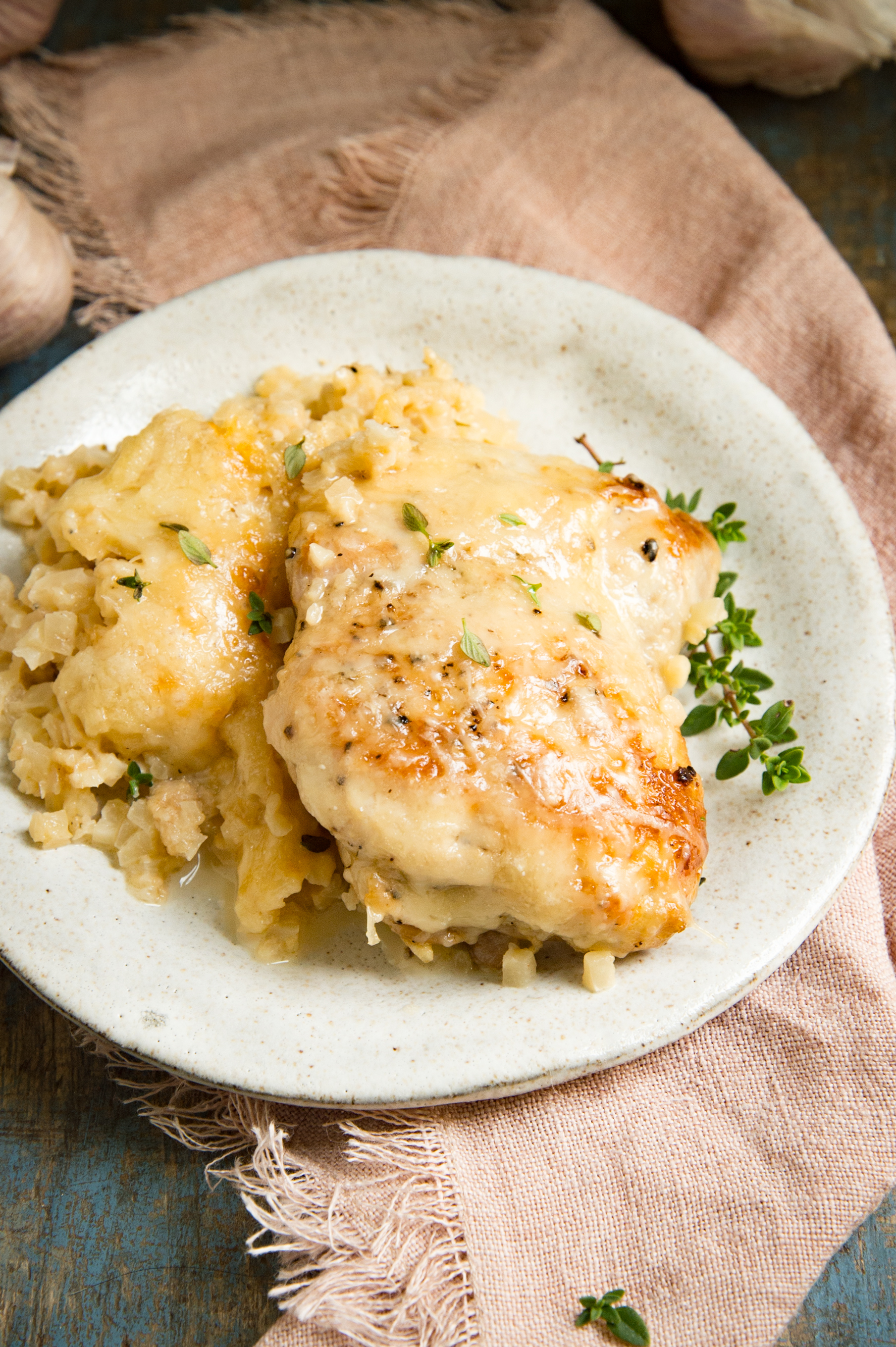 Low-Carb One Skillet Creamy Garlic Parmesan Chicken-on a plate.