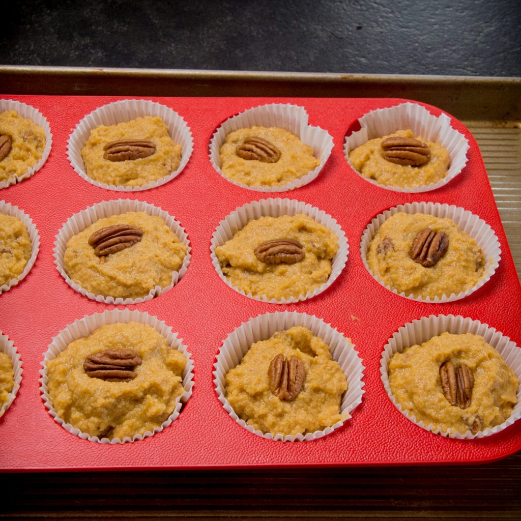 Filling silicon muffin cups with the batter.