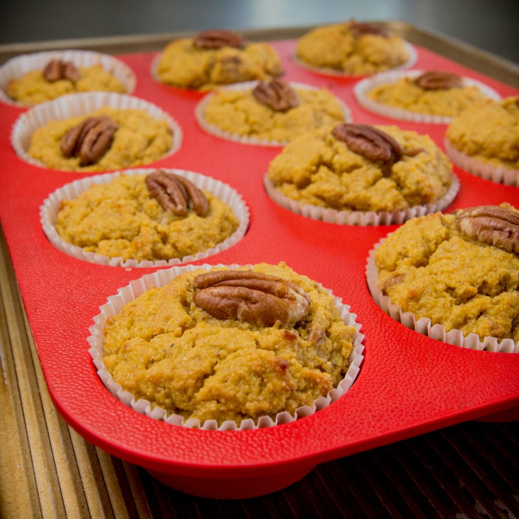 Low Carb Pumpkin Spice Muffins on a silicon muffin tray.