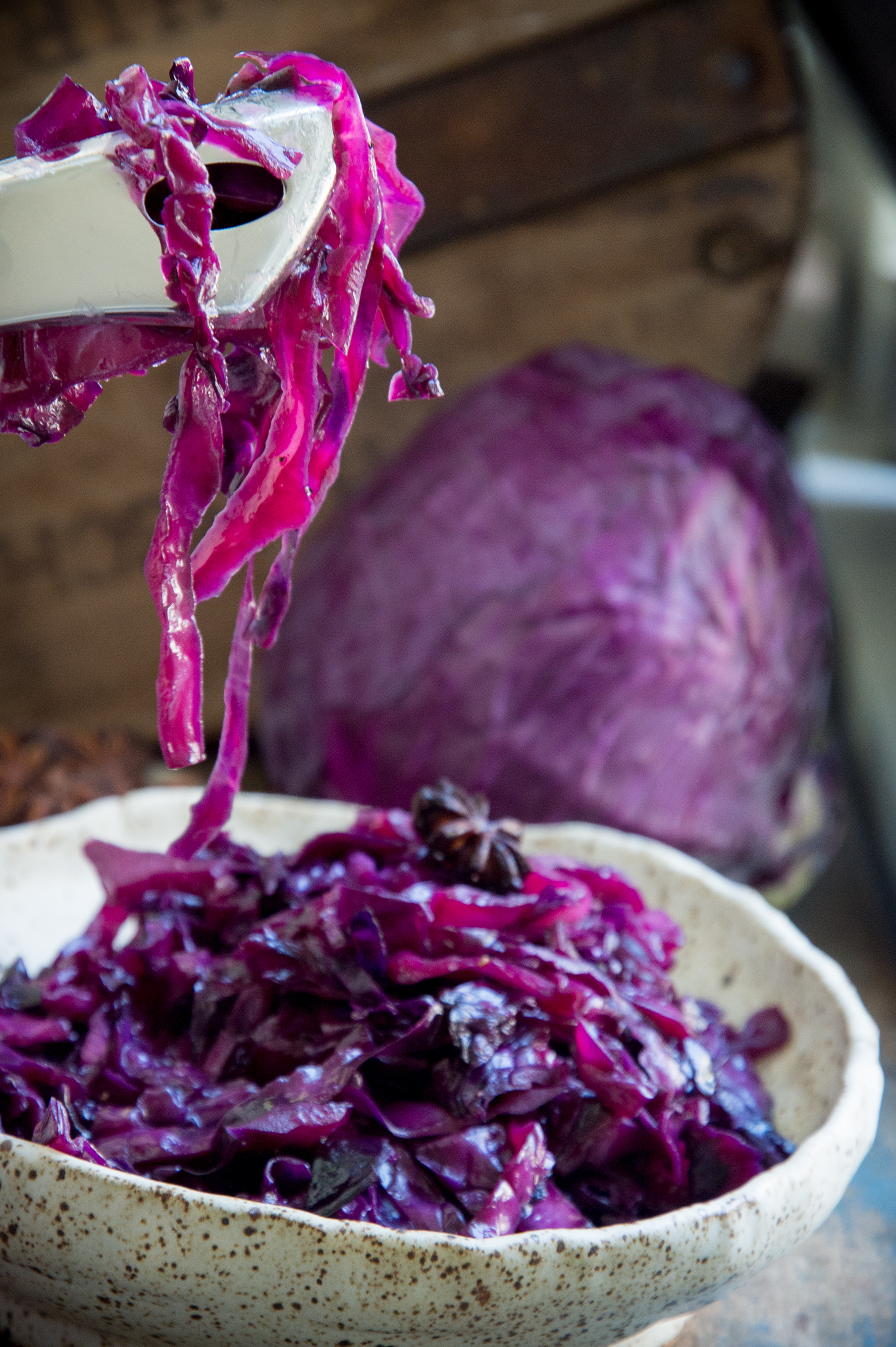Low-Carb Sweet and Sour Red Cabbage-serving using tongs.