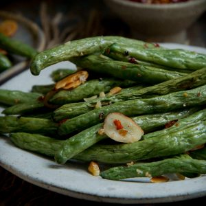 Close-up photo of Low-Carb Roasted Green Beans on a plate.