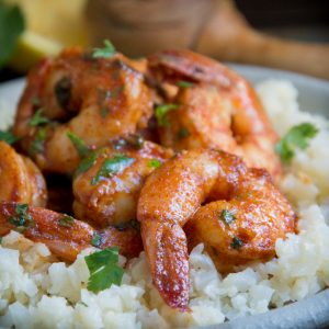 Close up photo of Low-Carb Spicy Baked Shrimp on a plate.