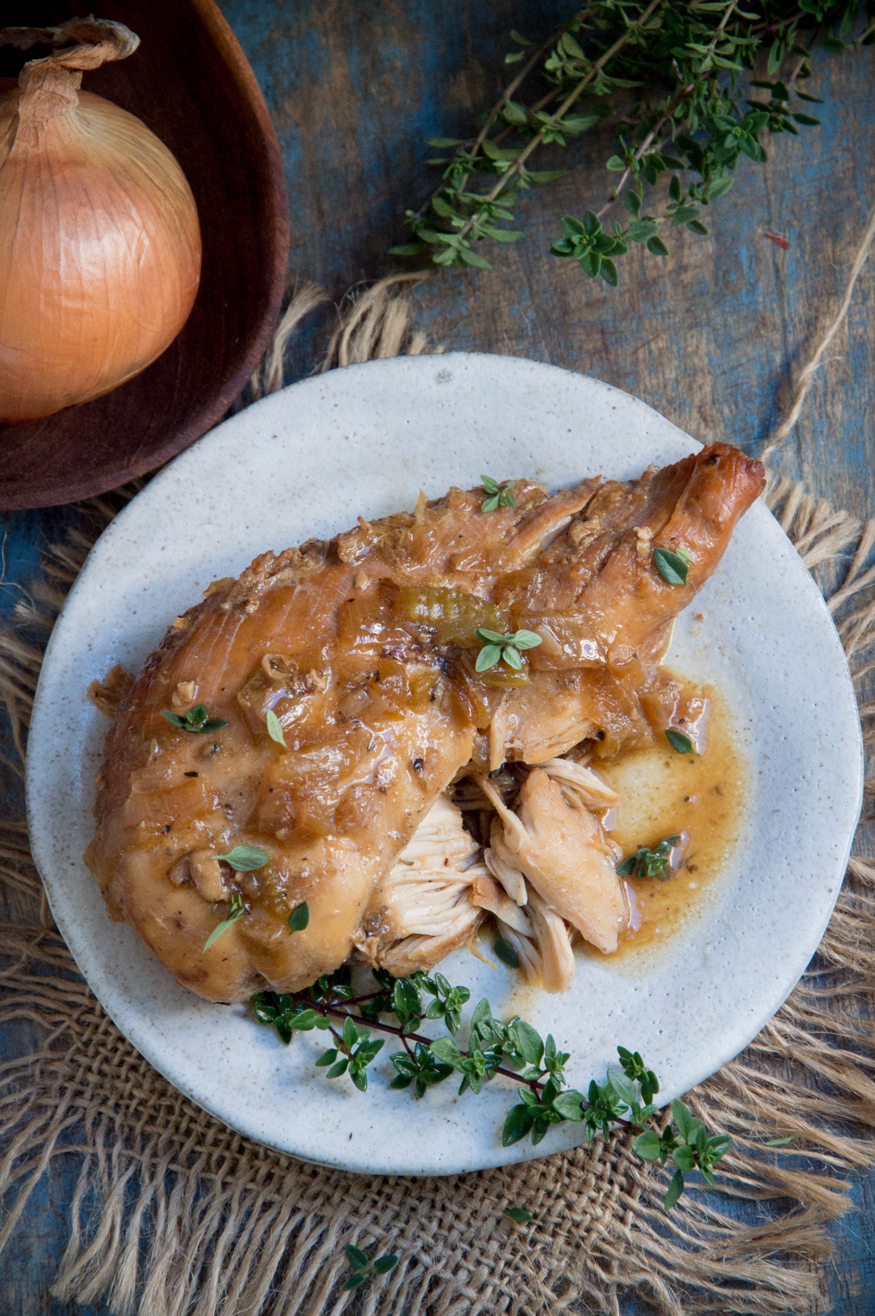 Easy Keto-Friendly Crockpot Chicken-served with sauce.