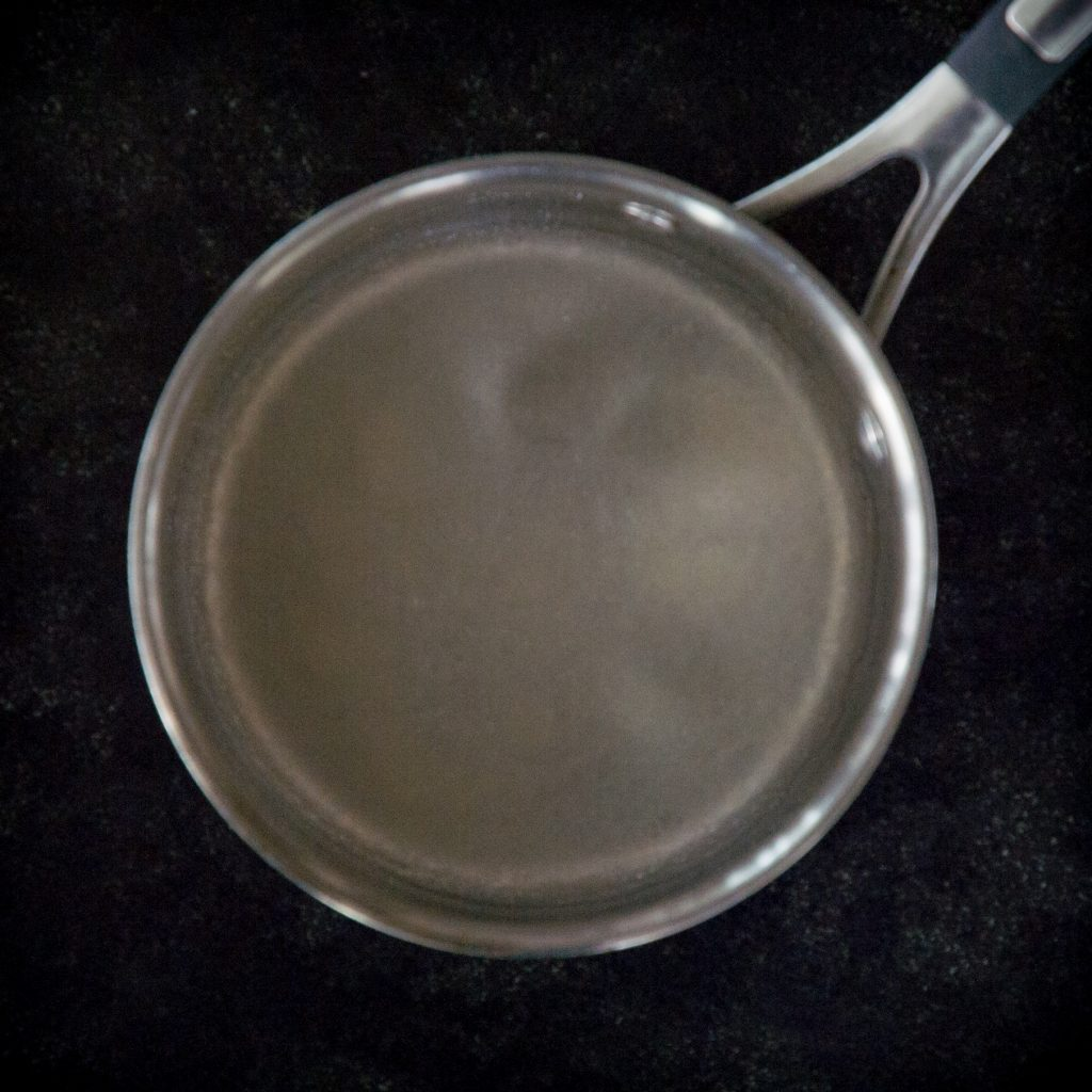 Blooming gelatin in a saucepan.