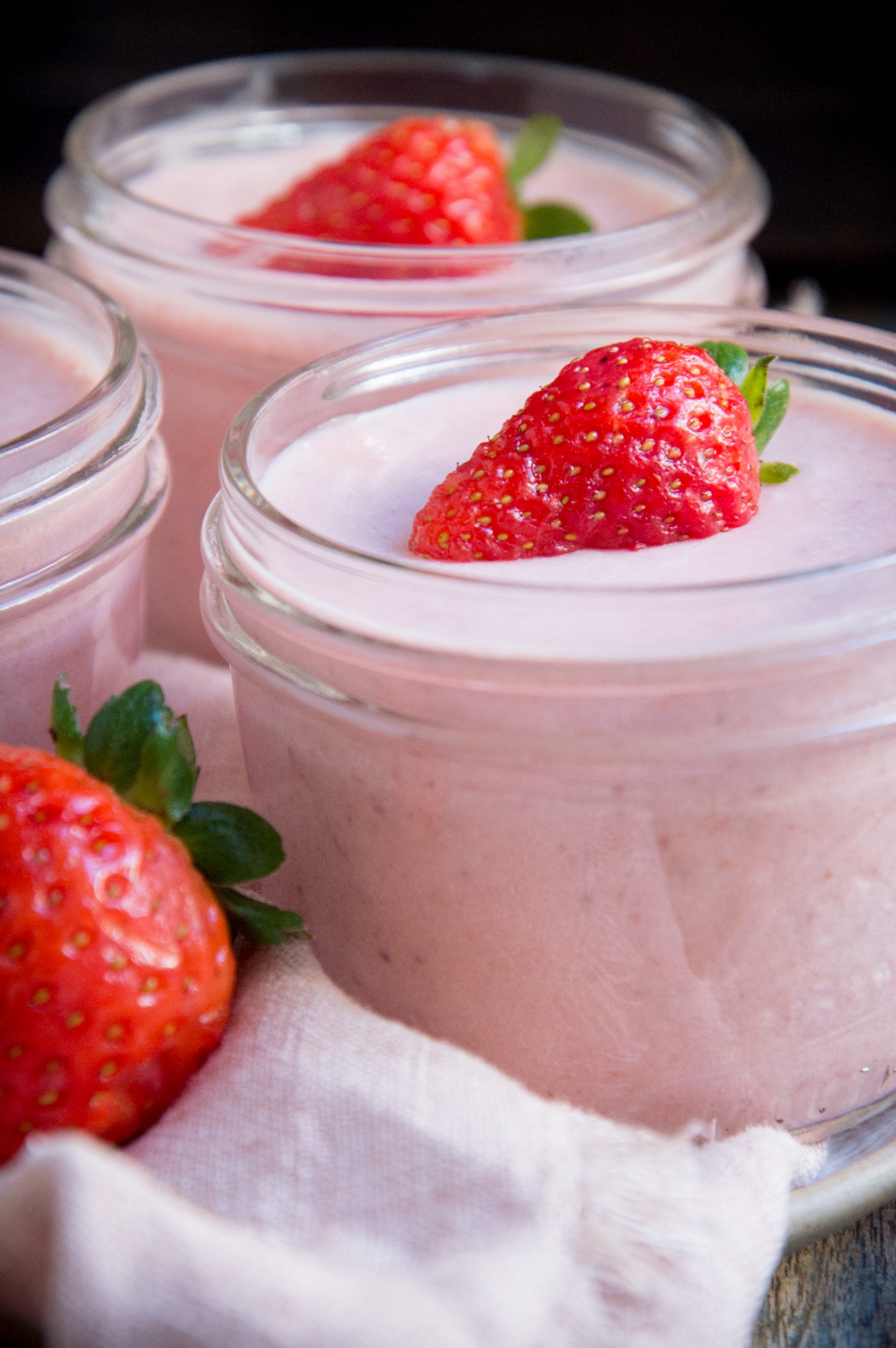 Mousse with strawberry wedges on top.