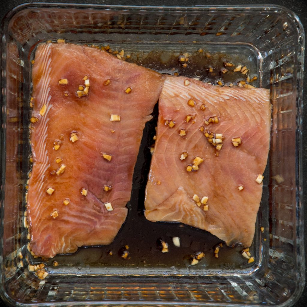 Overhead shot of raw salmon with marinade.