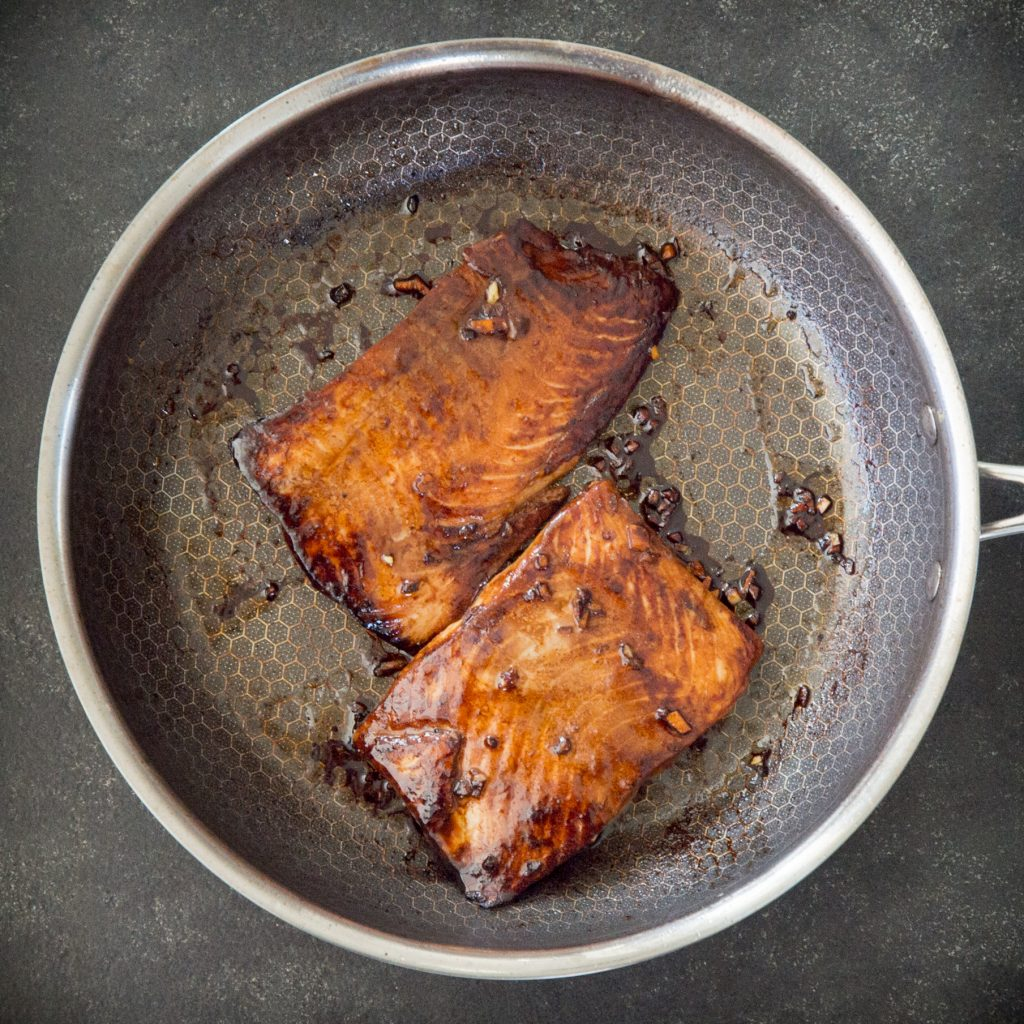 Overhead photo of salmon cooking in a pan.