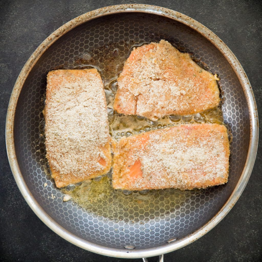 Cooking the salmon on a pan.