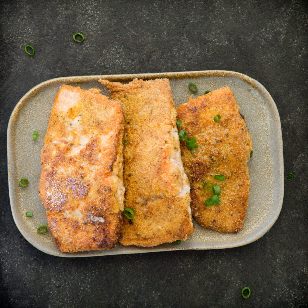 Overhead photo of three pieces of Cajun Crusted Salmon.