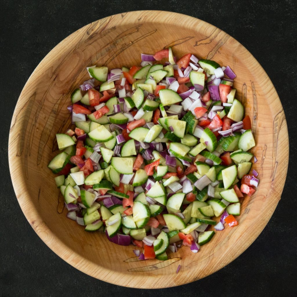 Photo of mixed Mediterranean Salad ingredients in a bowl.