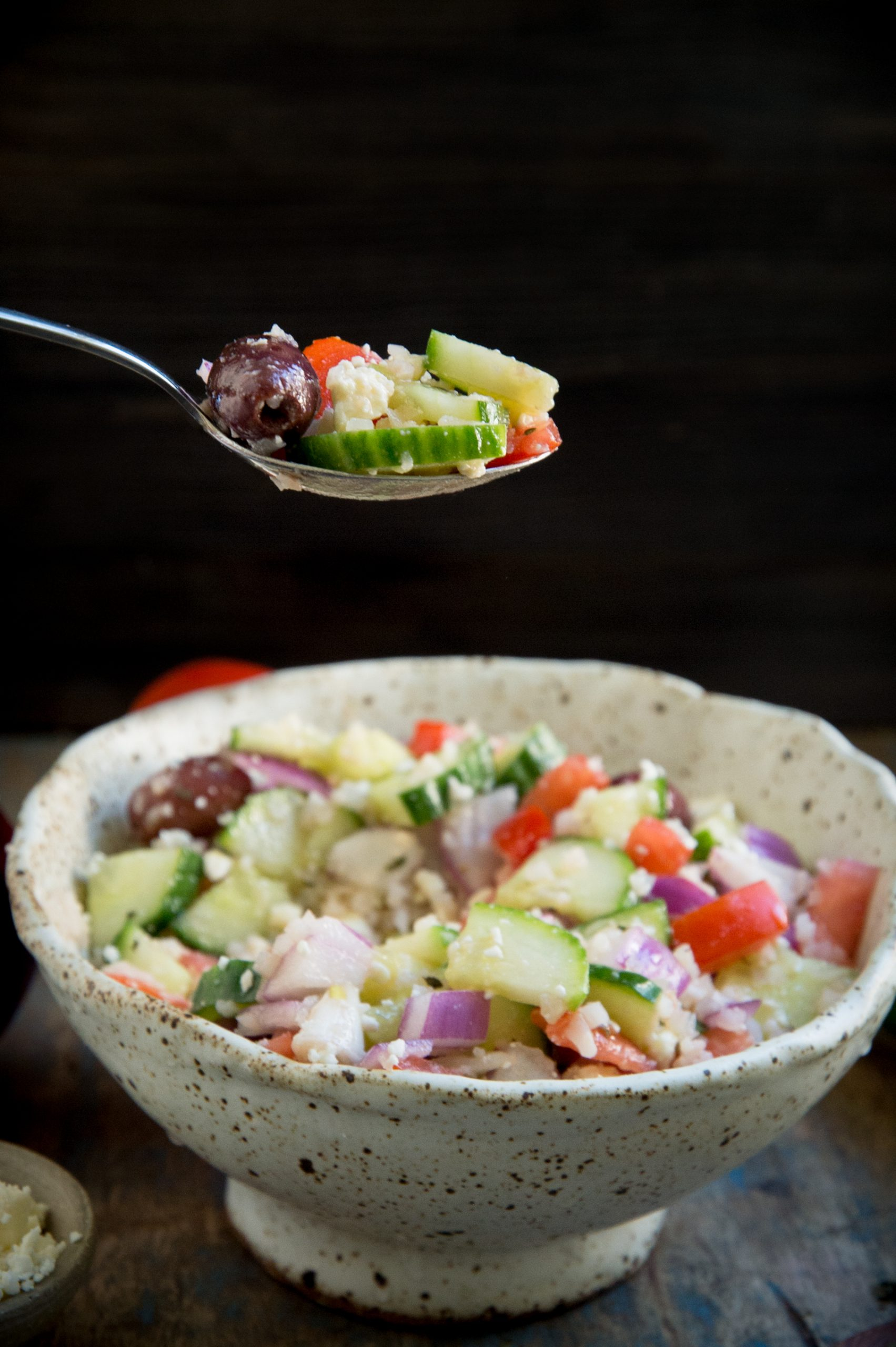 Mediterranean Salad with cucumbers and tomatoes. Bite shot.