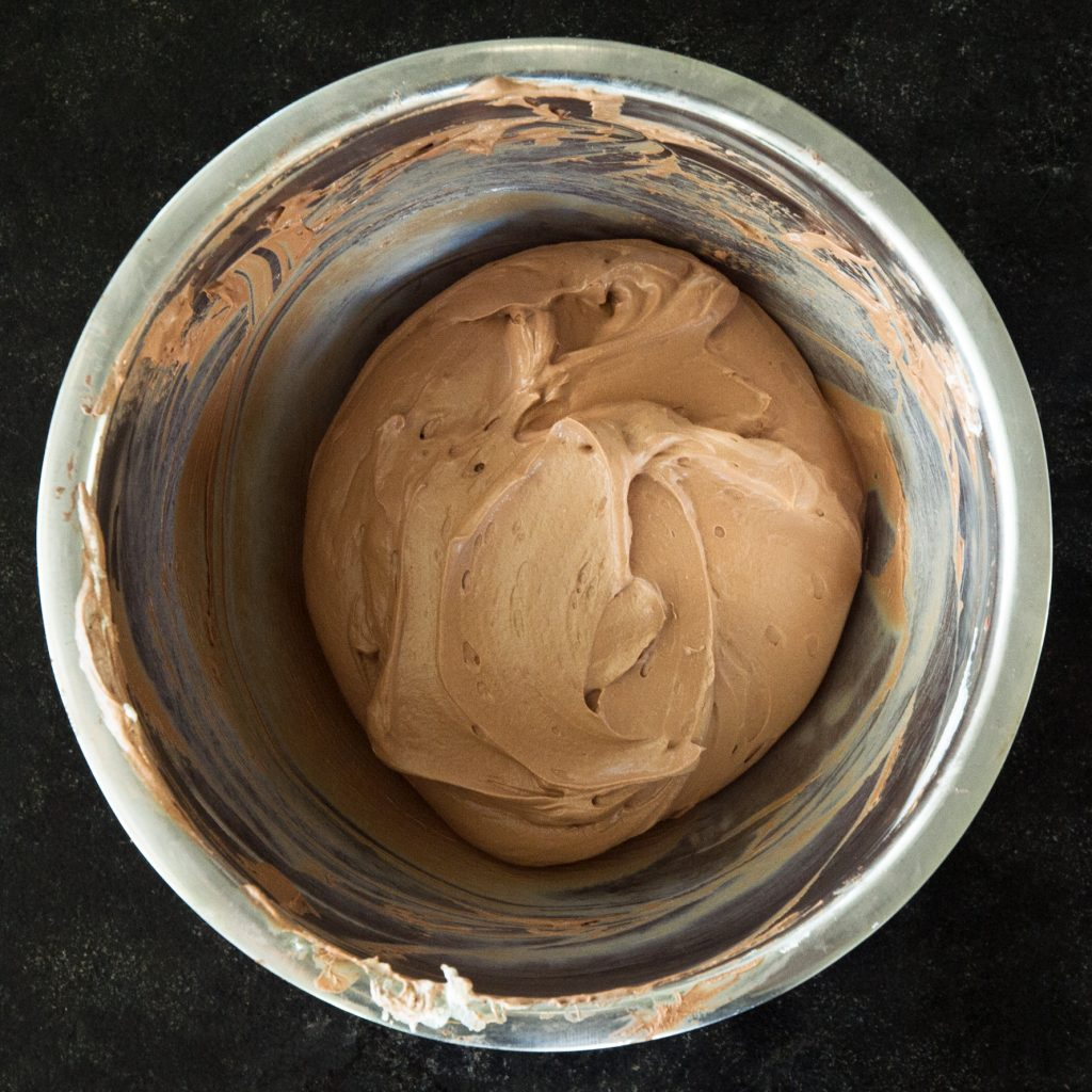 Final process photo of completed chocolate frosting.