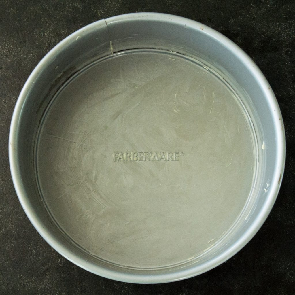 Overhead photo of buttered cake pan.