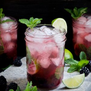 Image with three glasses of low-carb blackberry mojito.