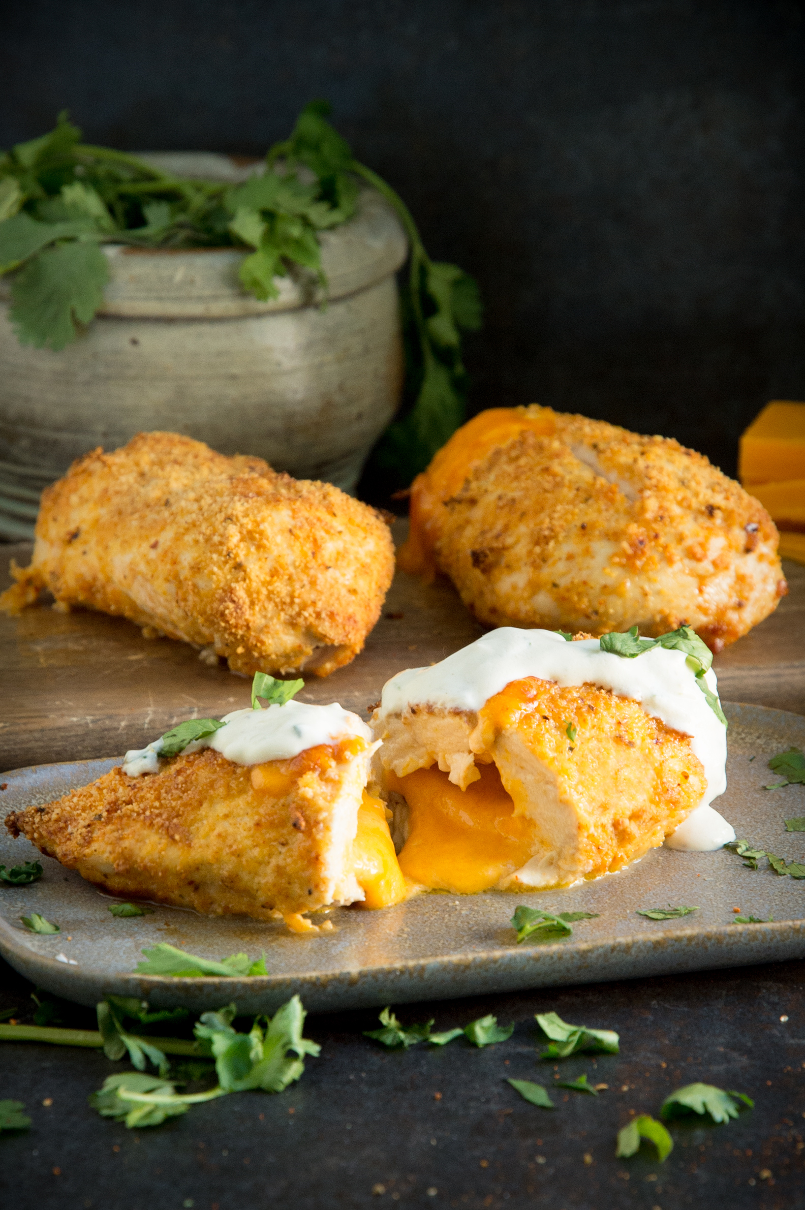 Cheese spilling out of Taco Crusted Cheese Stuffed Chicken Breasts
