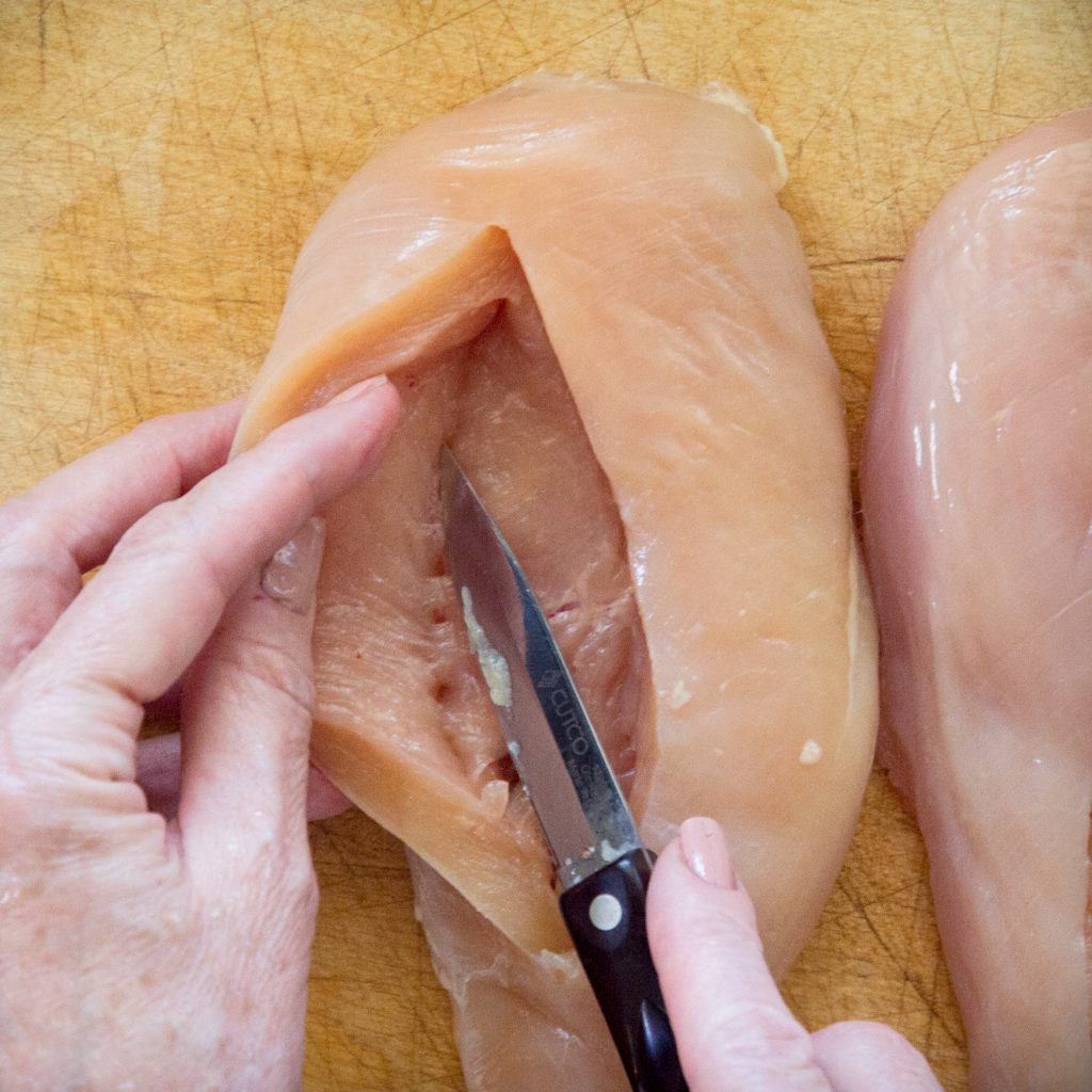Process photo of creating the cavity in the chicken breast.