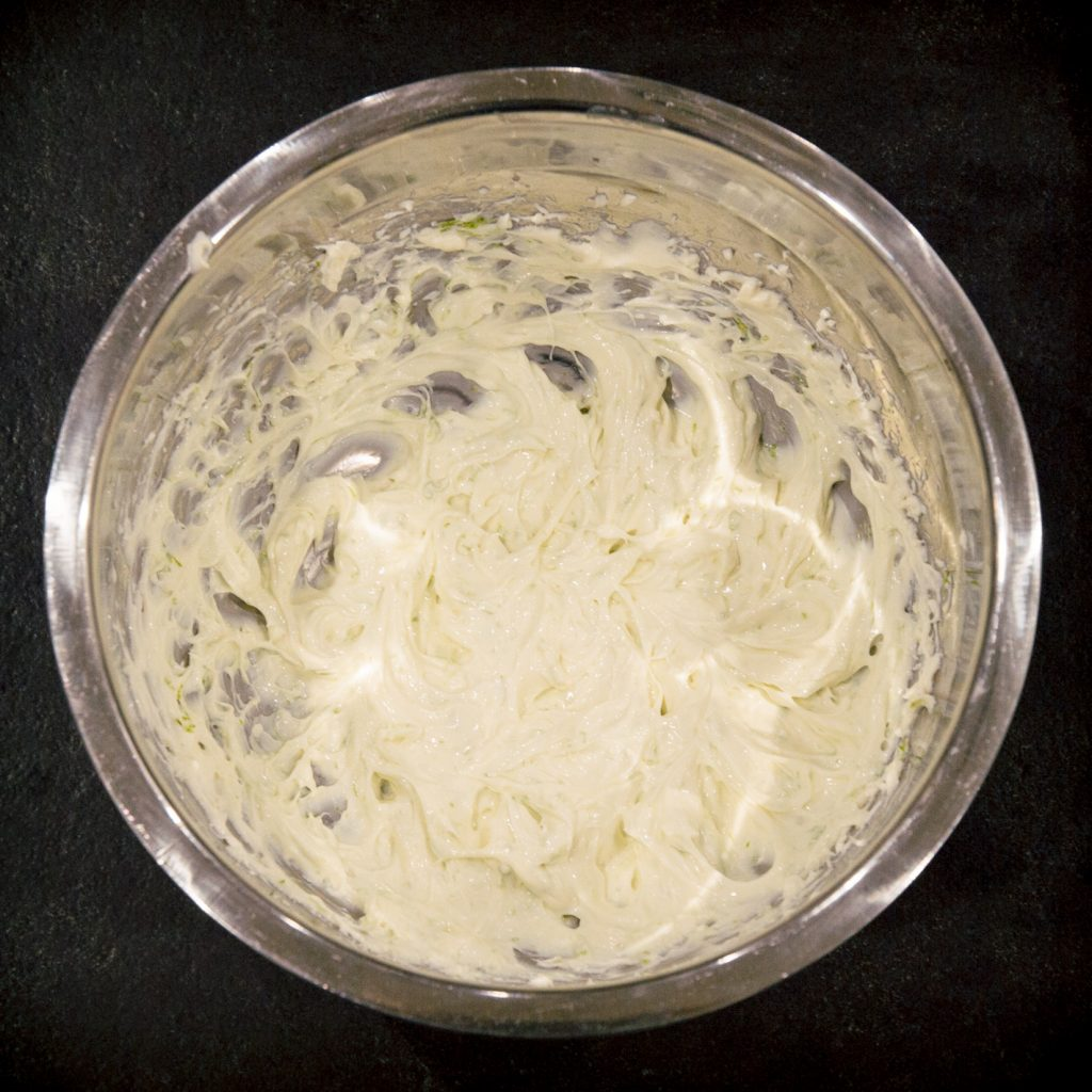 Process photo of cheesecake mixture in a bowl.