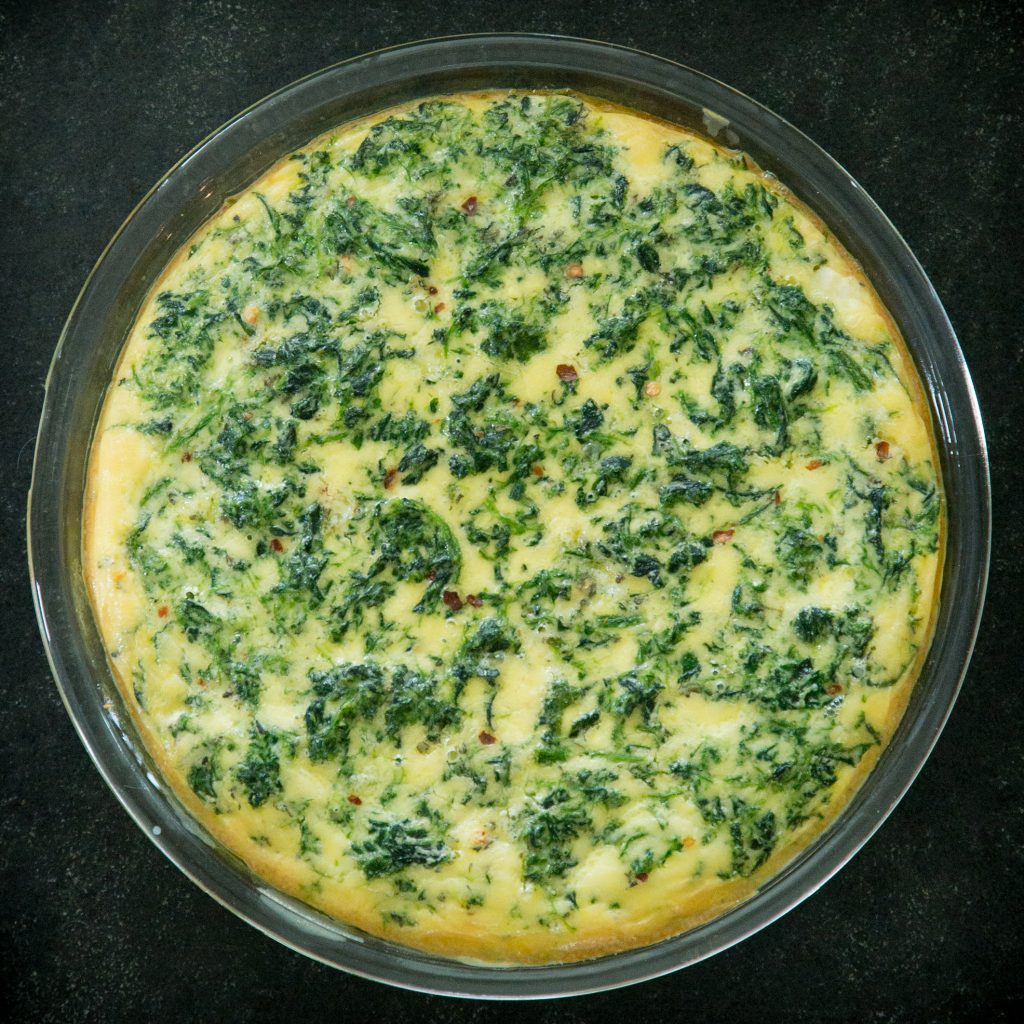Crustless spinach quiche after it has baked.