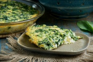 Crustless Spinach Quiche-One slice on a plate.