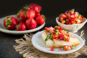 Fish Fillets with Strawberry Salsa spooned over.