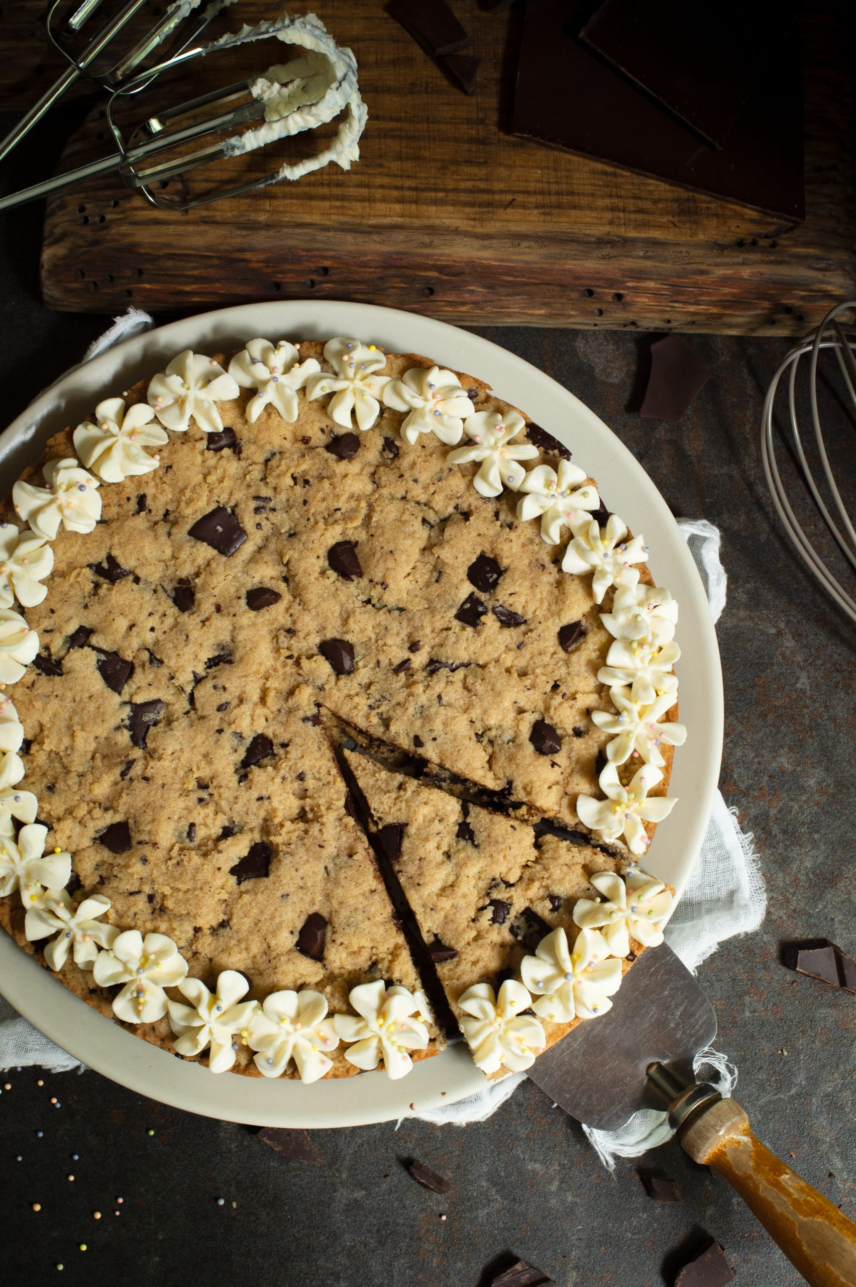 Overhead photo of slice of Keto cookie cake being lifted with a pie cutter