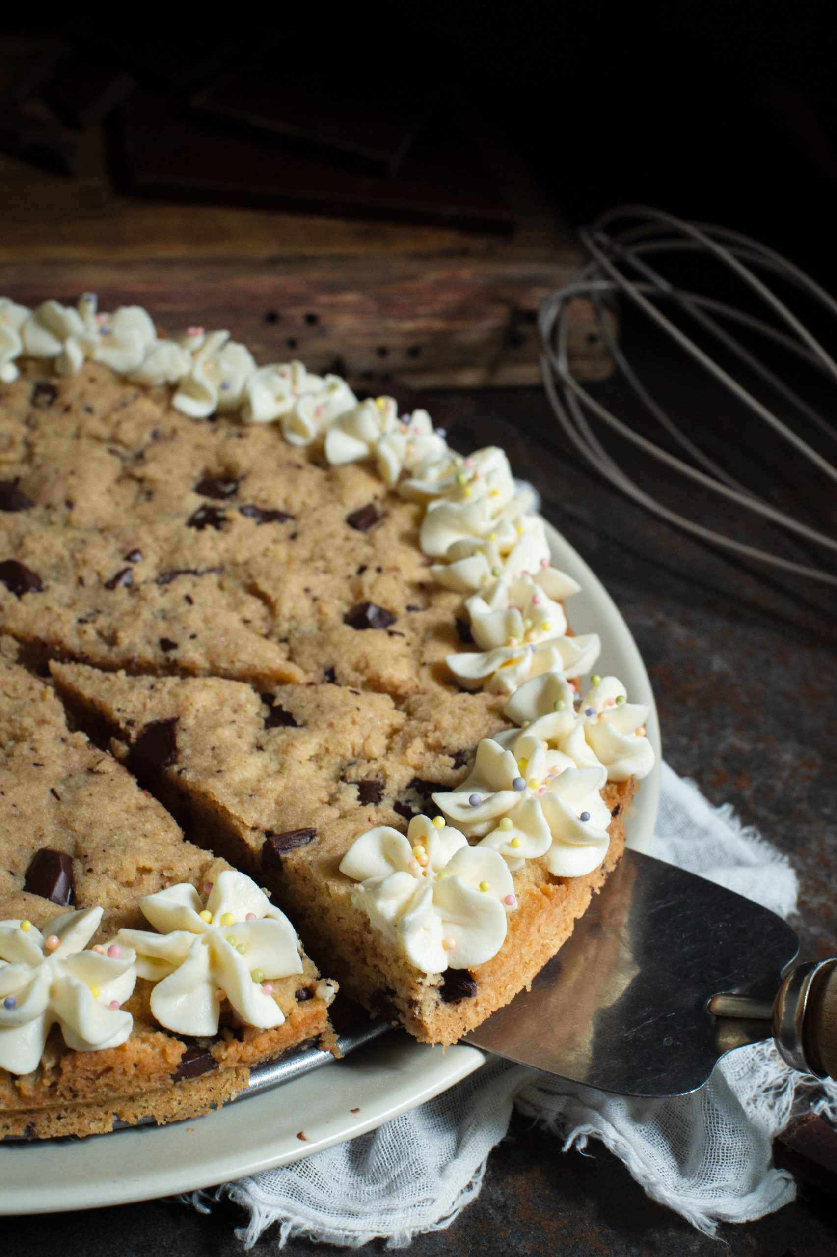 Slice of Keto cookie cake being lifted with a pie cutter