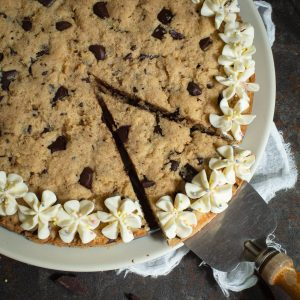 Slice of Keto cookie cake being lifted with a pie cutter.