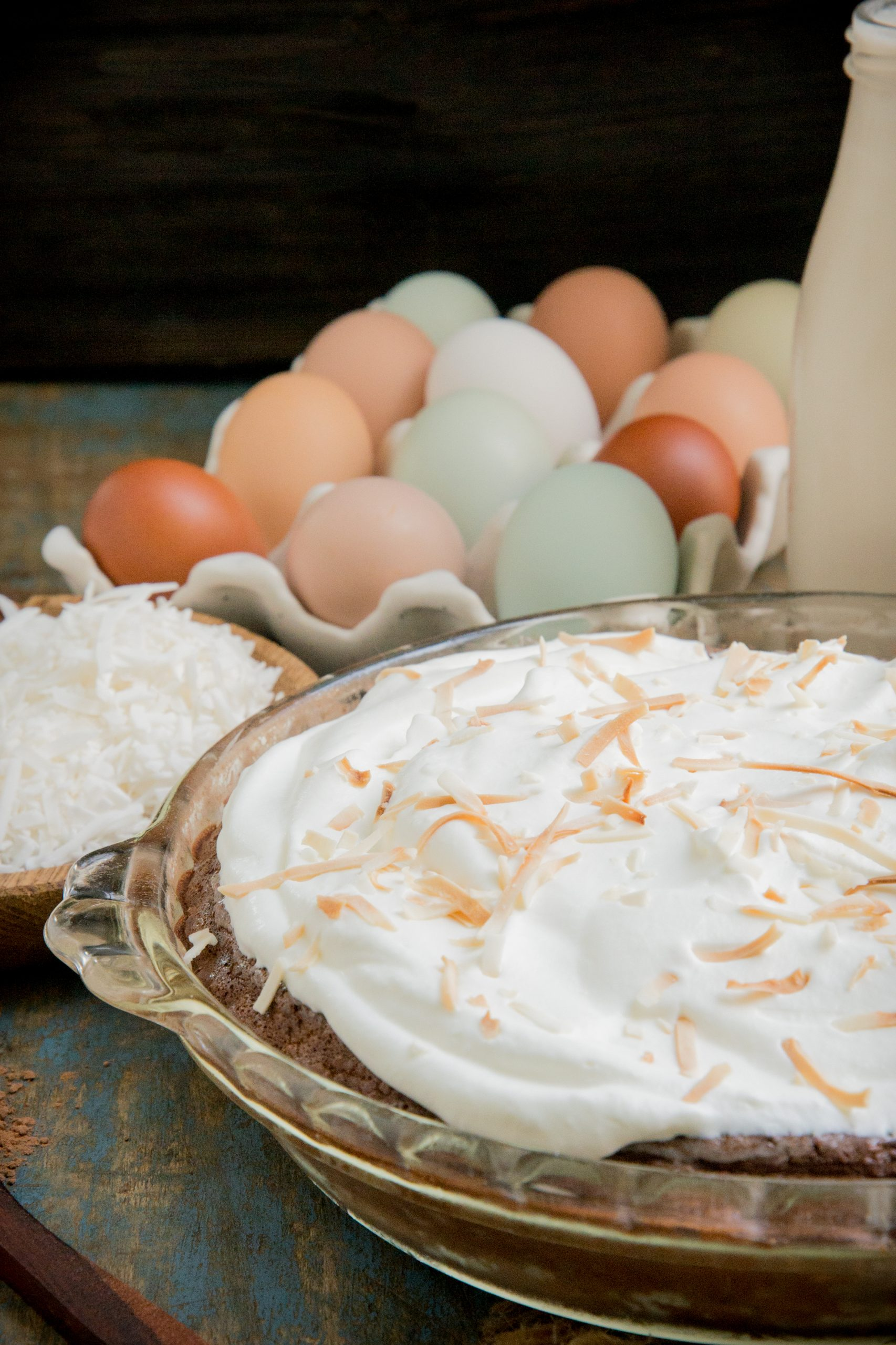 A photo of the whole pie with eggs behind.