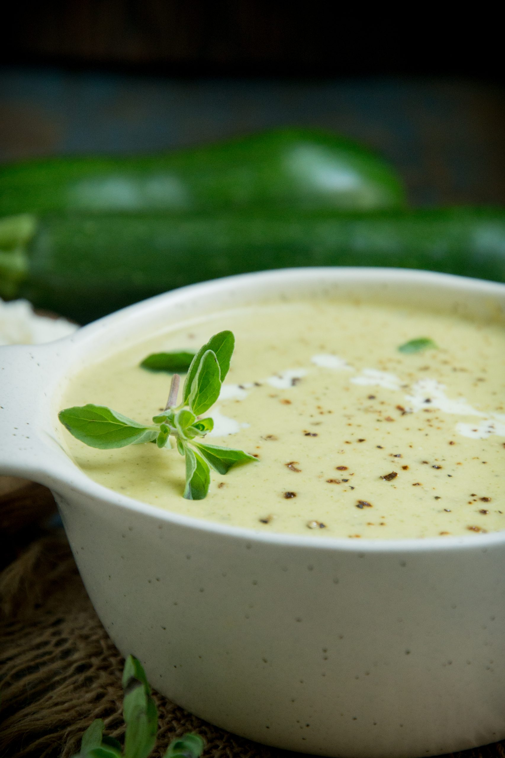 Close up shot of cream of zucchini soup.