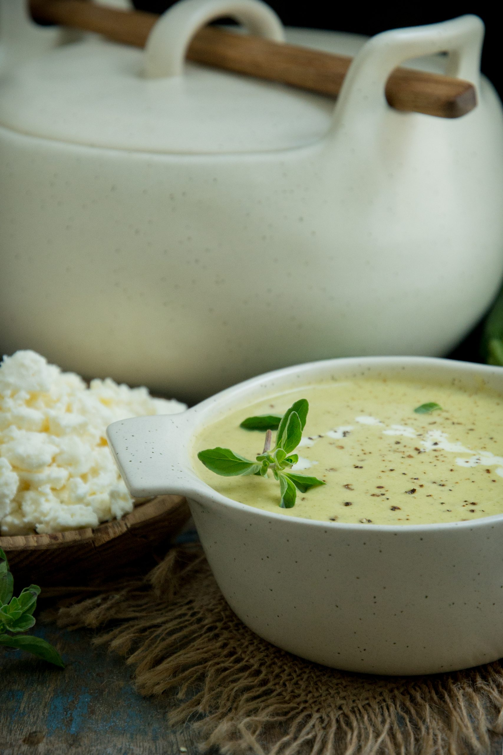 Zucchini Soup with soup pot and feta.