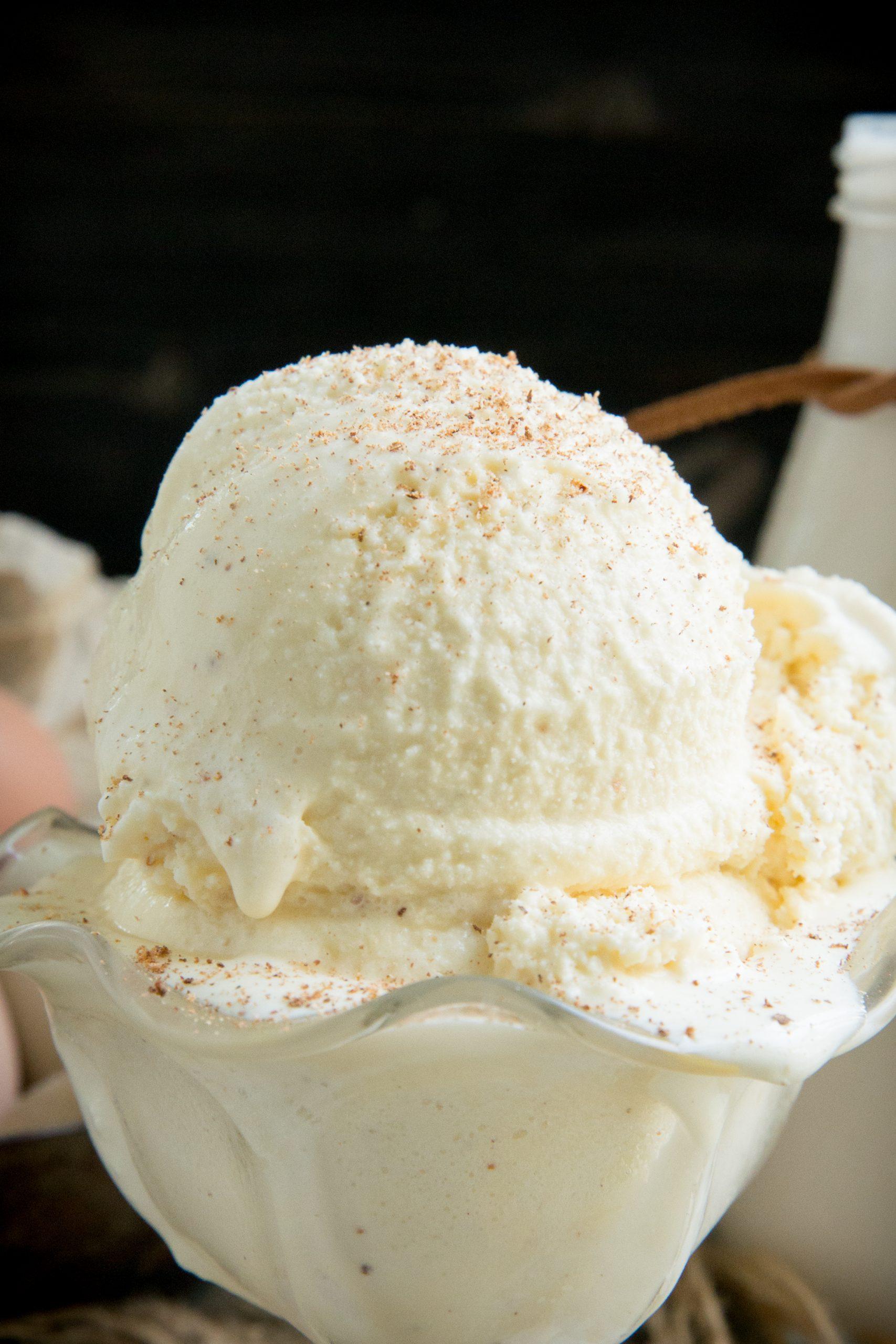 Nutmeg sprinkled over eggnog ice cream