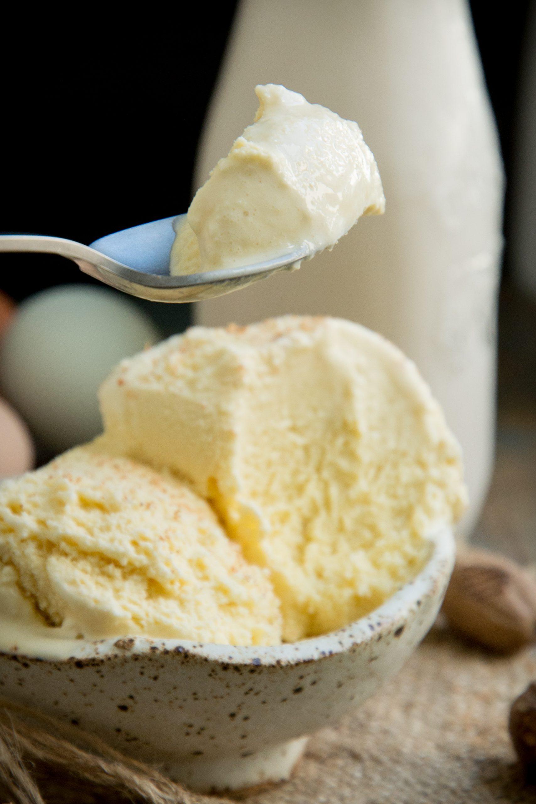 Taking a spoonful of keto eggnog ice cream.