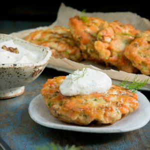 Keto Salmon Cake with Dill Sauce on top.