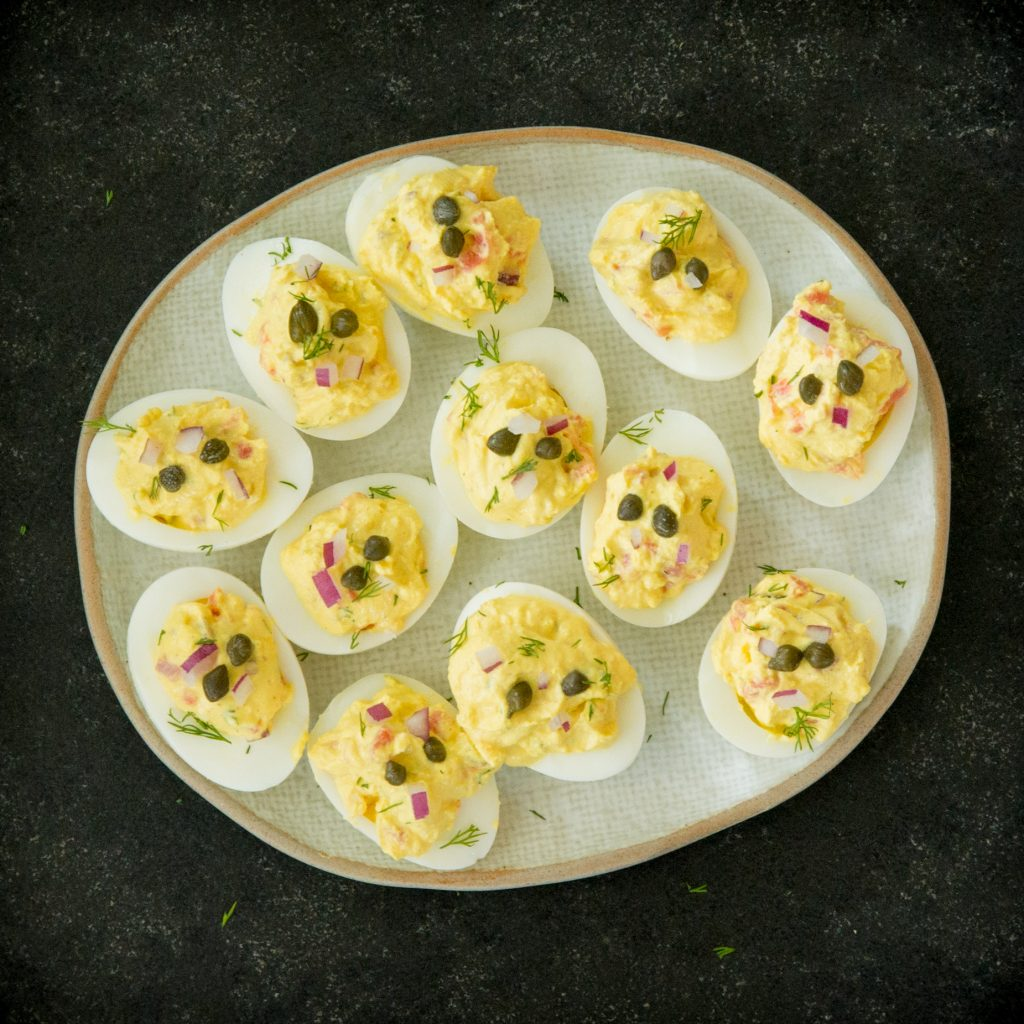 Filled eggs garnished with capers.