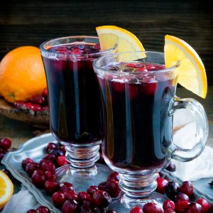 Low carb cranberry mulled wine garnished with orange slice.