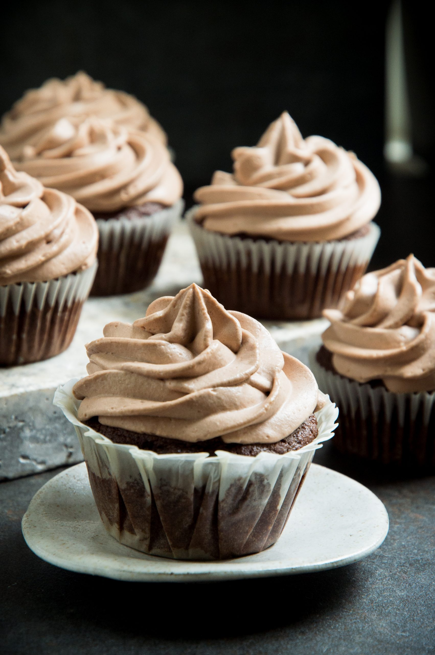 Photo of frosted cupcake on a small plate