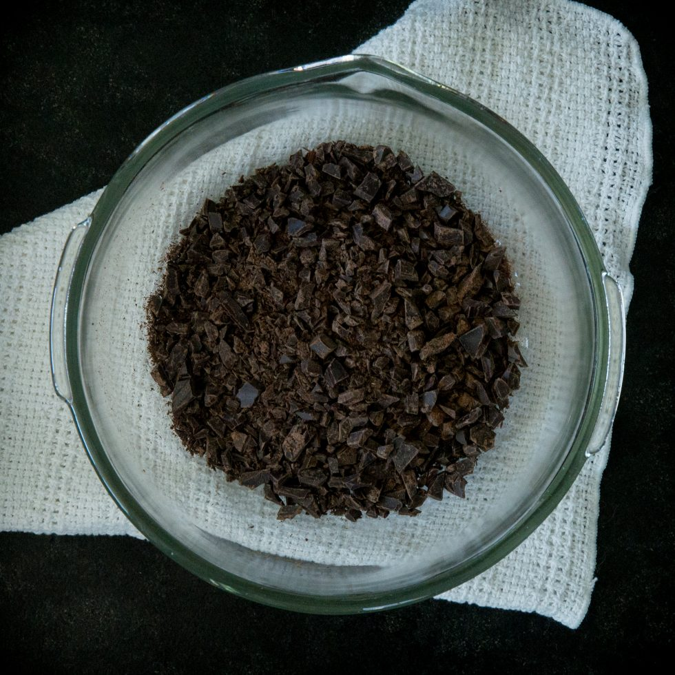 The chopped chocolate in a mixing bowl.