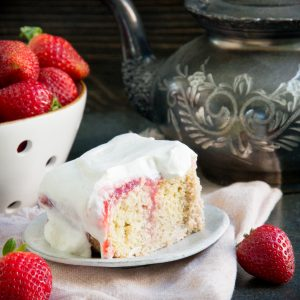 One serving of keto strawberry poke cake.