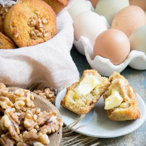 Banana nut muffins with butter.