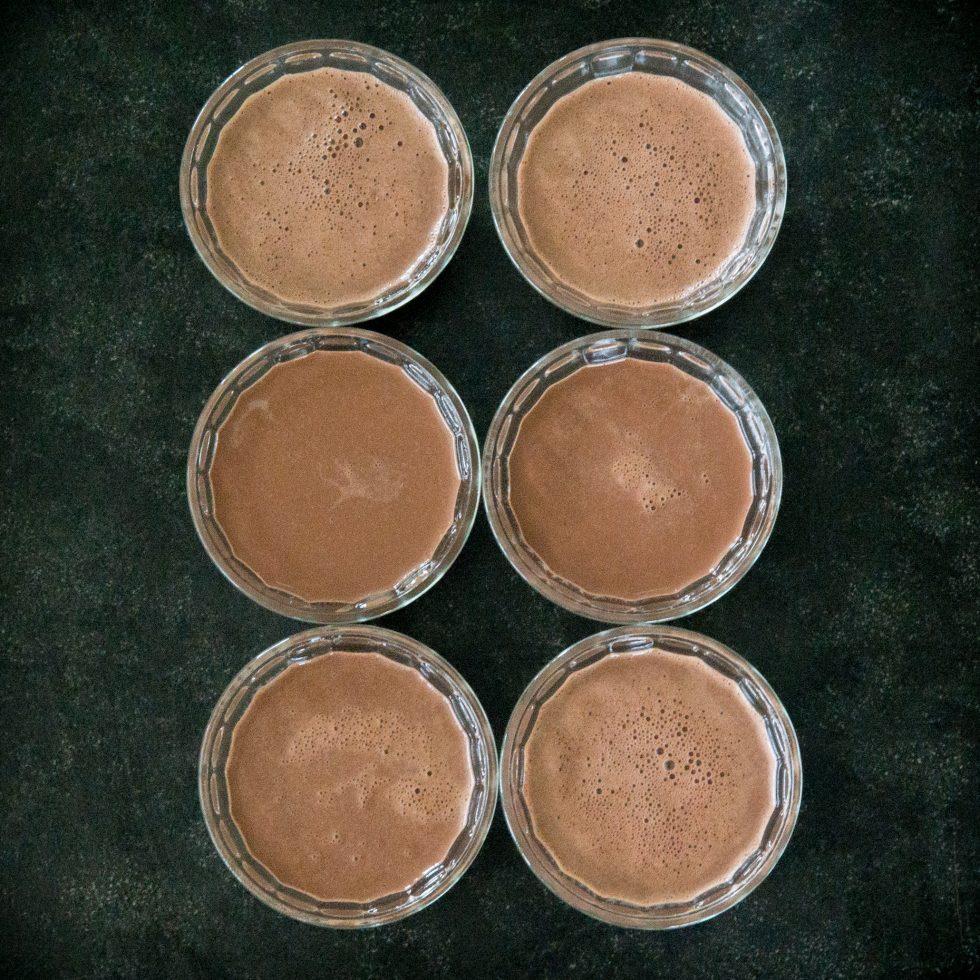 Chocolate Panna Cotta in the dessert cups.