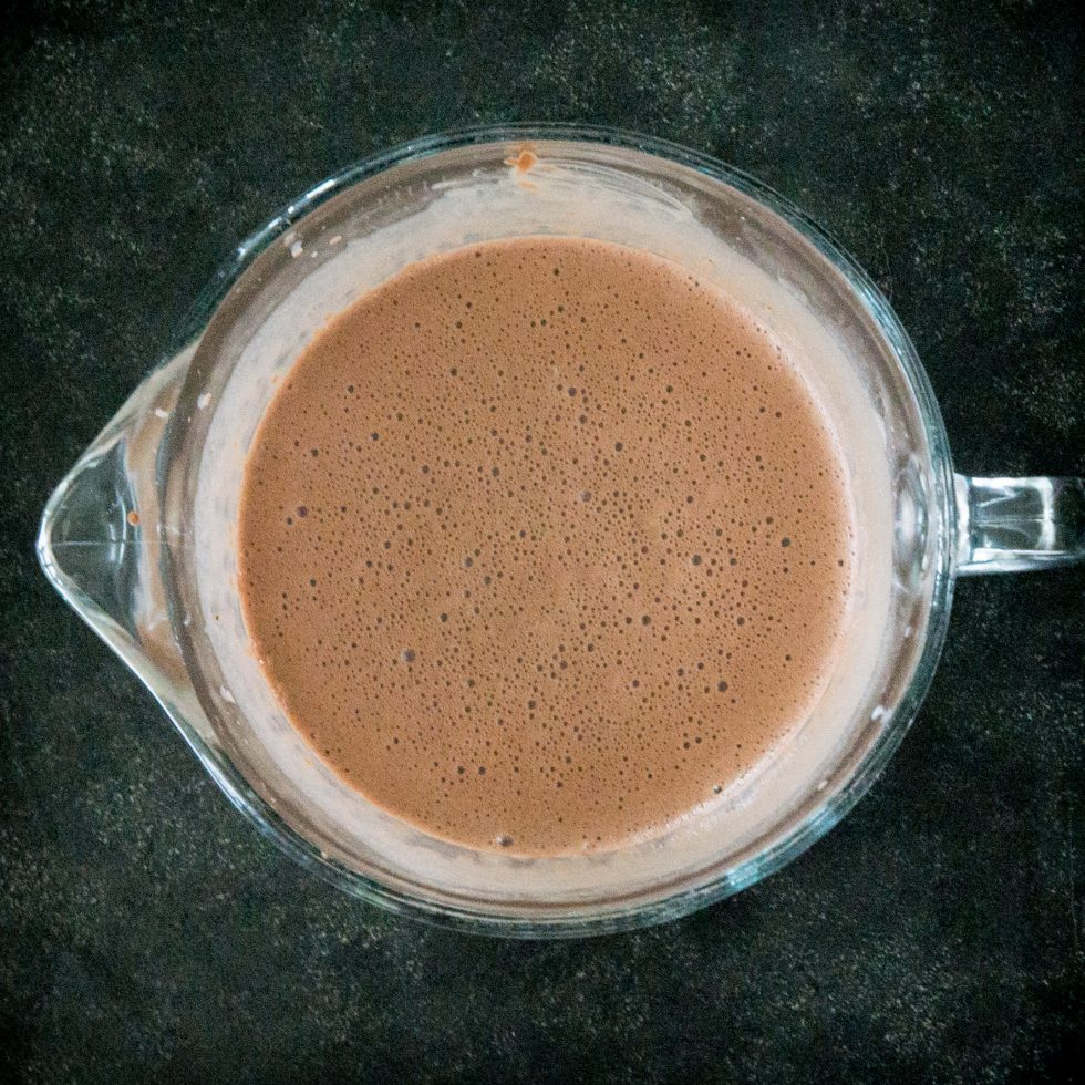 Adding the gelatin mixture to the chocolate mixture.