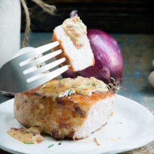 Pork chop with cream sauce.
